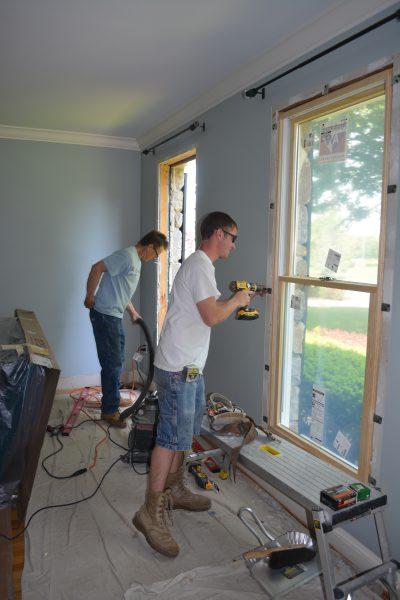 Gary & Jeremy installing window